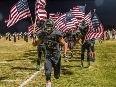 "A Southern California high school football team and  ""God Bless the U.S.A."""