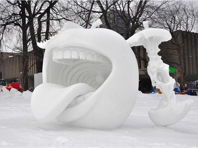 Does this amazing snow sculpture in Quebec City make you want to take a running dive right into that mouth?