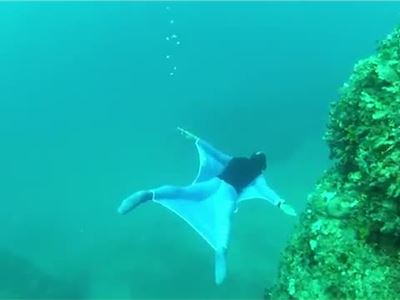 Freediver creates underwater wingsuit
