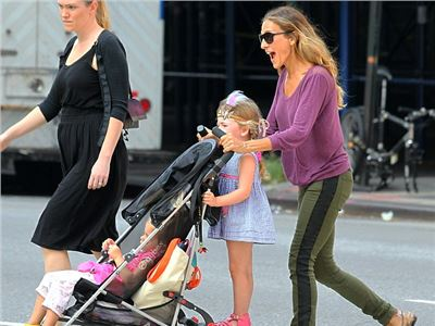 Sarah Jessica Parker  transforms from Fashion Week star to doting mother.